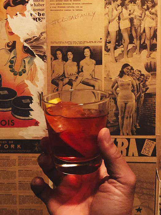 Negroni cocktail with old photos in the background