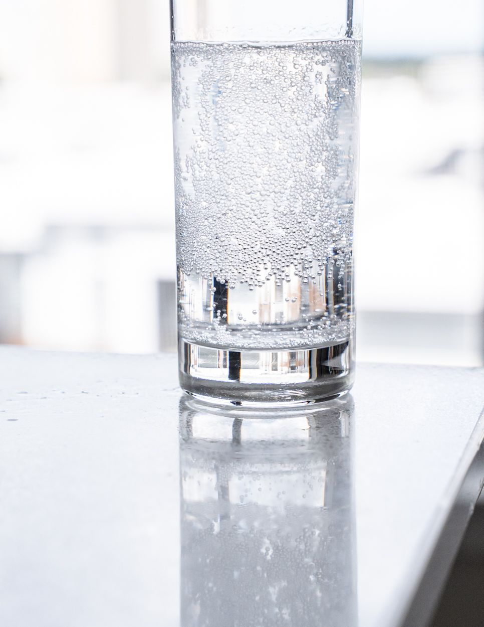 water glass with many hundreds of bubbles