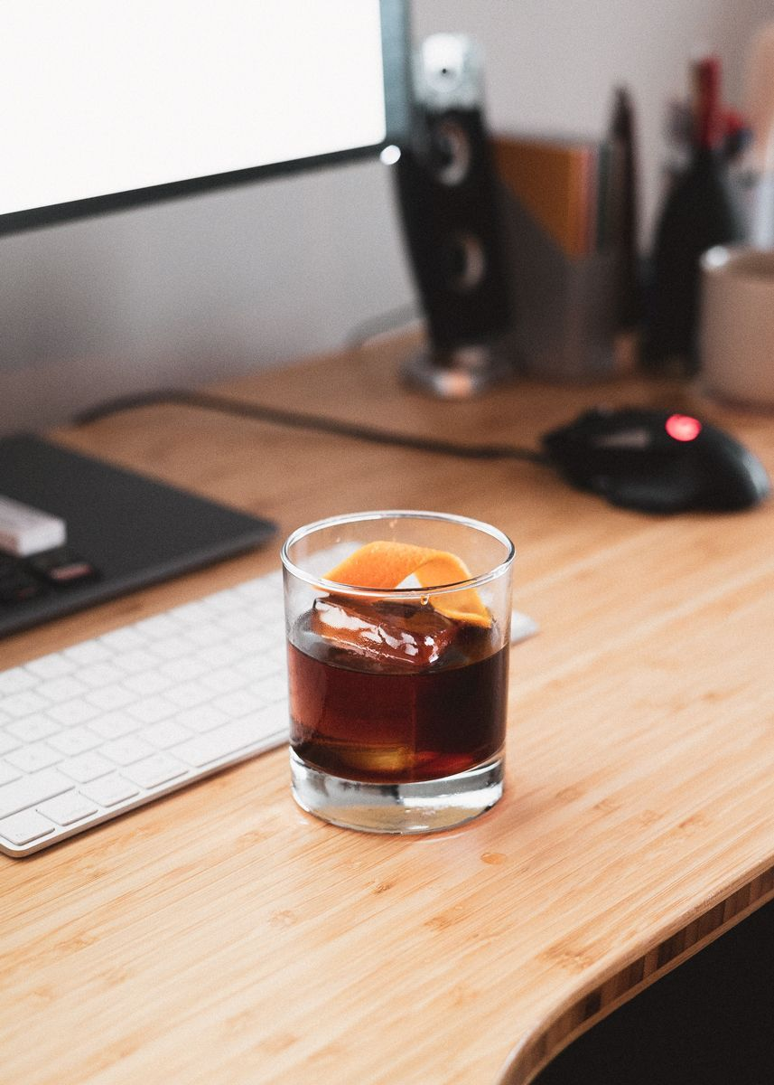 cold brew old fashioned drink on a work desk