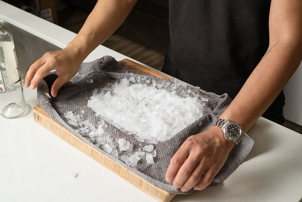 using a kitchen towel to crush ice 2