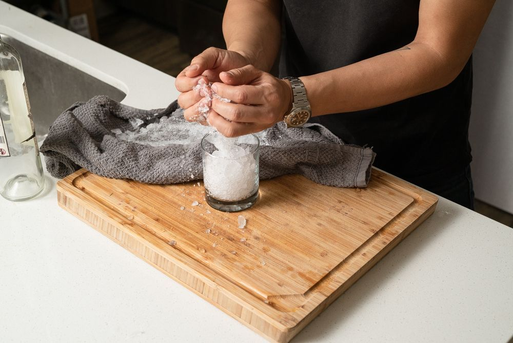 using a kitchen towel to crush ice 3