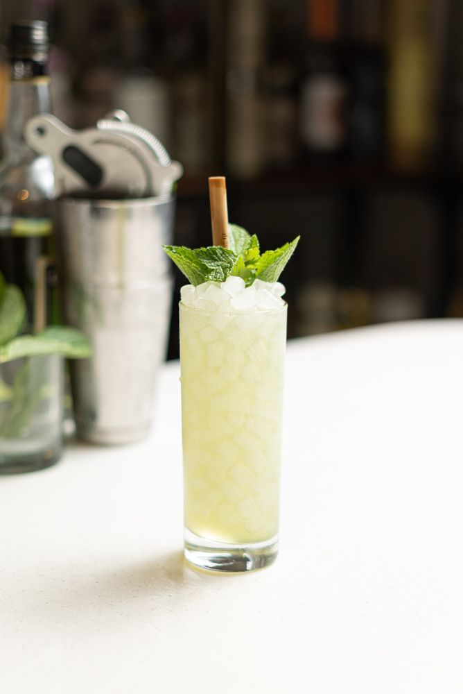 green chartreuse cocktail with pebble ice