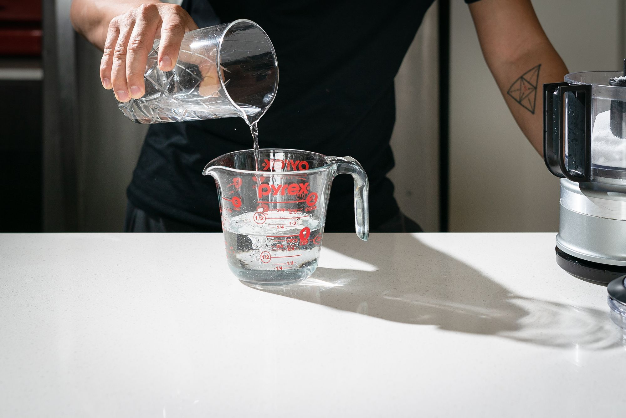 adding water to measuring cup